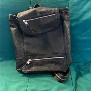 Drawstring flap top backpack